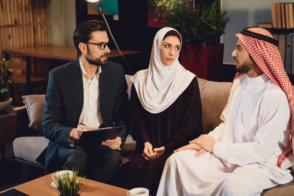 Muslim marriage counselor helping an Islamic couple.